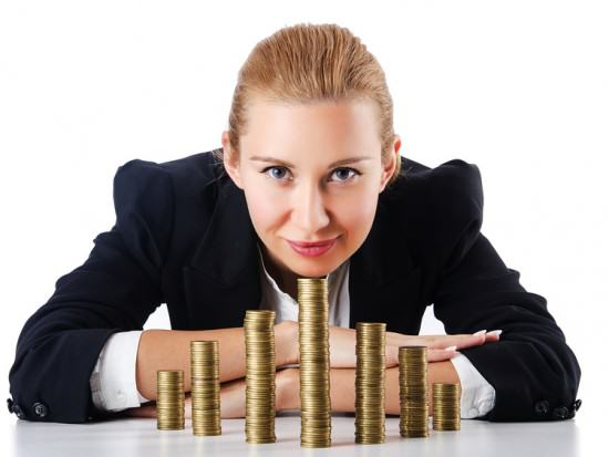 Businesswoman with coins on white